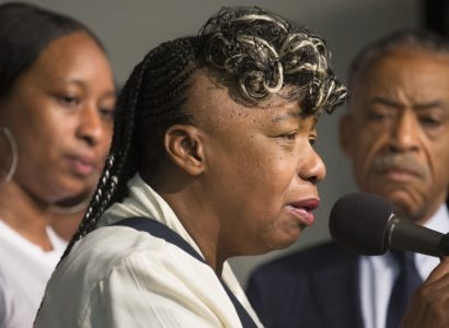 Gwen Carr, mother of Eric Garner, speaks alongside her daughter Ellisha Garner, left, and the Rev. Al Sharpton, right, during a rally at the National Action Network headquarters, Saturday, July 26, 2014, in New York. Eric Garner, 43, died on Thursday, July 18, during an arrest in Staten Island, when a plain-clothes police officer placed him in what appeared be a choke hold while several others brought him to the ground and struggled to place him in handcuffs. (AP Photo/John Minchillo)