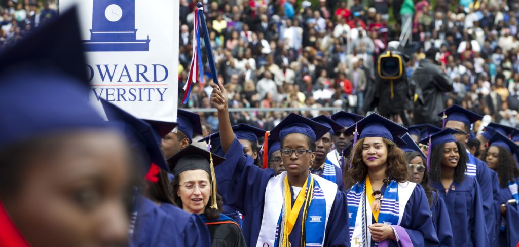 Graduate students walk to their places as their arrive to the 2016 Howard University graduation ceremony in Washington, Saturday, May 7, 2016. ( AP Photo/Jose Luis Magana)