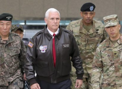 "U.S. Vice President Mike Pence arrives with U.S. Gen. Vincent Brooks, second from right, commander of the United Nations Command, U.S. Forces Korea and Combined Forces Command, and South Korean Deputy Commander of the Combined Force Command Gen. Leem Ho-young, left, at the border village of Panmunjom in the Demilitarized Zone (DMZ) which has separated the two Koreas since the Korean War, South Korea, Monday, April 17, 2017. Viewing his adversaries in the distance, Pence traveled to the tense zone dividing North and South Korea and warned Pyongyang that after years of testing the U.S. and South Korea with its nuclear ambitions, ""the era of strategic patience is over."" (AP Photo/Lee Jin-man)"