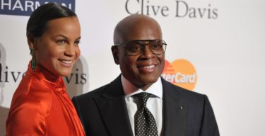 "Music producer and honoree Antonio ""L.A."" Reid, right, and Erica Reid arrive at the Clive Davis Pre-GRAMMY Gala on Saturday, Feb. 9, 2013 in Beverly Hills, Calif. (Photo by John Shearer/Invision/AP)"