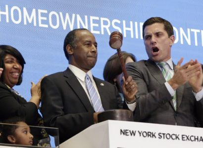 U.S. Secretary of Housing and Urban Development Ben Carson is cheered on by New York Stock Exchange President Tom Farley, right, as he gavels trading closed from the bell podium of the NYSE, Monday, June 12, 2017. Carson's wife, Lacena Carson, is second from left. (AP Photo/Richard Drew)