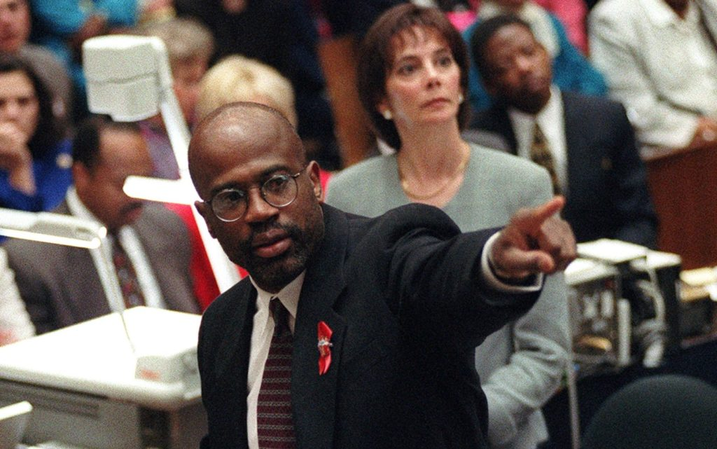 Prosecutor Christopher Darden points at a chart during his closing arguments as Marcia Clark looks on, Friday, Sept. 29, 1995, in a Los Angeles courtroom during the O.J. Simpson double-murder trial. (AP Photo/Reed Saxon, pool)