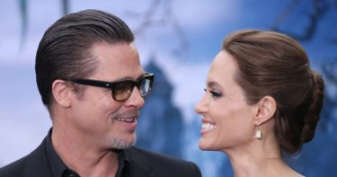 Actors Brad Pitt and Angelina Jolie pose for photographers as they arrive for the Maleficent exhibit in Kensington Gardens, London, Thursday, May 8, 2014. The exhibit showcases some of the costumes and props from the film Maleficent, before they go on display to the public at the O2 in London. (Joel Ryan/Invision/AP Images)