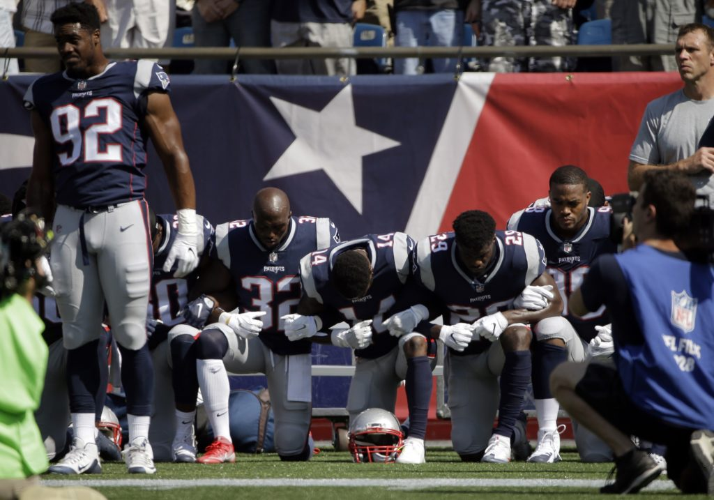Several New England Patriots players kneel during the national anthem before an NFL football game against the Houston Texans, Sunday, Sept. 24, 2017, in Foxborough, Mass. (AP Photo/Steven Senne)