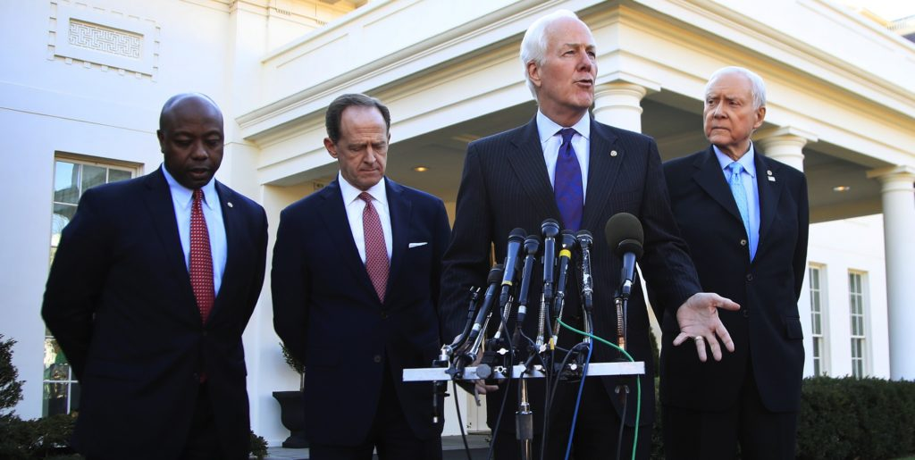 Senate Finance Committee member Sen. John Cornyn, R-Texas, second from right, with, from left, Sens. Tim Scott, R-S.C., Patrick Toomey, R-Pa., and Chairman Orrin Hatch, R-Utah, speaks to reporters following a meeting with President Donald Trump at the White House in Washington, Monday, Nov. 27, 2017. (AP Photo/Manuel Balce Ceneta)