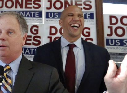 Democratic senatorial candidate Doug Jones, center, speaks during a campaign rally along side Sen. Cory Booker, D-N.J., right, and Rep. Terri Sewell, left, Sunday, Dec. 10, 2017, in Birmingham, Ala. (AP Photo/Brynn Anderson)