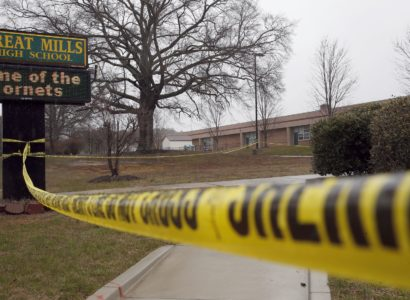 Crime scene tape is used around Great Mills High School, the scene of a shooting, Tuesday, March 20, 2018, in Great Mills. A student with a handgun shot two classmates inside the school before he was fatally wounded during a confrontation with a school resource officer, a sheriff said. (AP Photo/Alex Brandon)