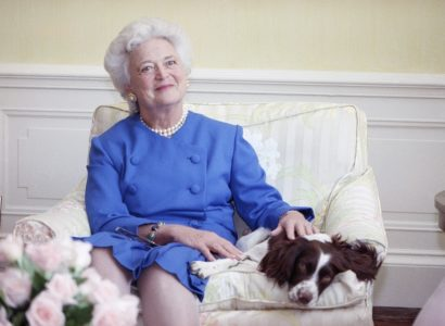 First Lady Barbara Bush poses with her dog Millie in 1990. (AP Photo/Doug Mills)