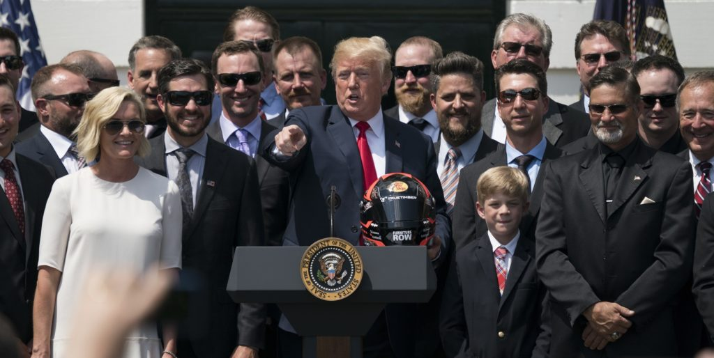 President Donald Trump poses with 2017 NASCAR Cup champion Martin Truex Jr., second from left, Truex's long time girlfriend Sherry Pollex, left, and members of his racing team during a ceremony on the South Lawn of the White House in Washington, Monday, May 21, 2018. (AP Photo/Andrew Harnik)