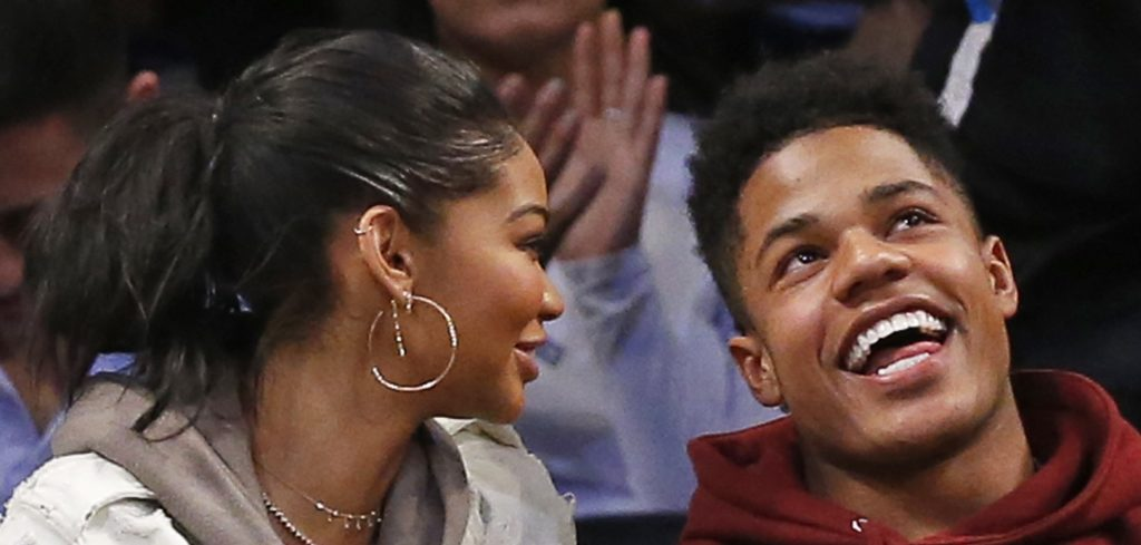 Model Chanel Iman, left, sits with New York Giants wide receiver Sterling Shepard in the second half of an NBA basketball game between the Brooklyn Nets and the New Orleans Pelicans, Thursday, Jan. 12, 2017, in New York. The Pelicans defeated the Nets 104-95. (AP Photo/Kathy Willens)