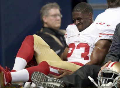 San Francisco 49ers running back Reggie Bush is taken off on a cart during the first quarter of an NFL football game against the St. Louis Rams Sunday, Nov. 1, 2015, in St. Louis. (AP Photo/Tom Gannam)