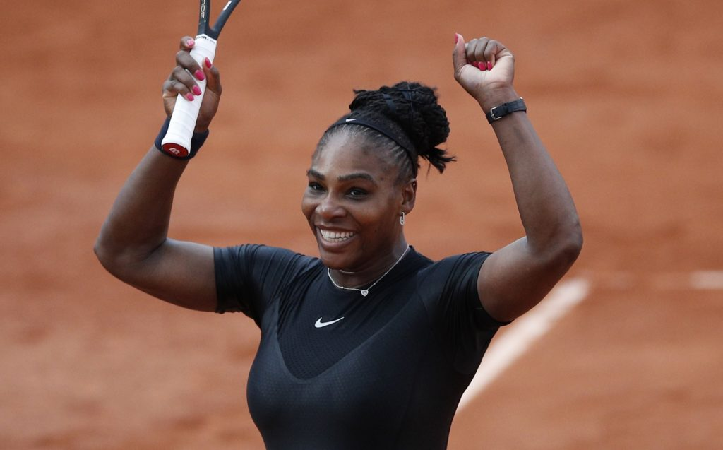 Serena Williams of the U.S. celebrates winning her third round match against Germany's Julia Georges of the French Open tennis tournament at the Roland Garros stadium in Paris, France, Saturday, June 2, 2018. (AP Photo/Christophe Ena )