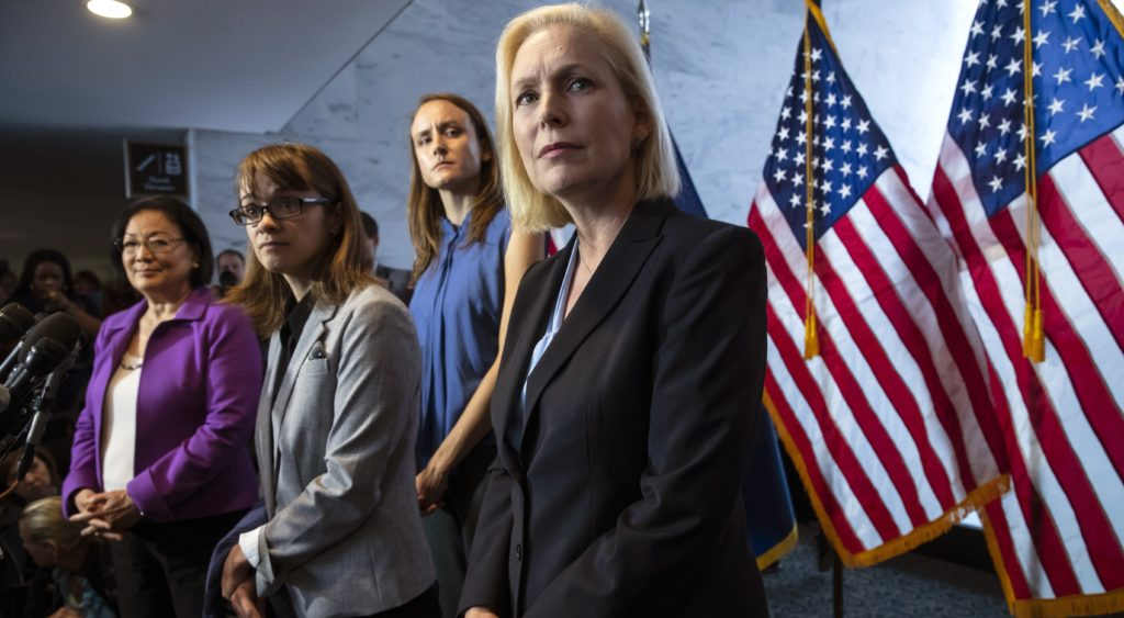 From left, Sen. Mazie Hirono, D-Hawaii, Alexis Goldstein and Sarah Burgess, alumnae of the Holton-Arms School, and Sen. Kirsten Gillibrand, D-N.Y., speak at a news conference in support of Christine Blasey Ford, who is accusing Supreme Court nominee Brett Kavanaugh of a decades-old sexual attack, during a news conference on Capitol Hill in Washington, Thursday, Sept. 20, 2018. Holton Arms is the Maryland all-girls school that Christine Blasey Ford attended in the early 1980s. (AP Photo/J. Scott Applewhite)