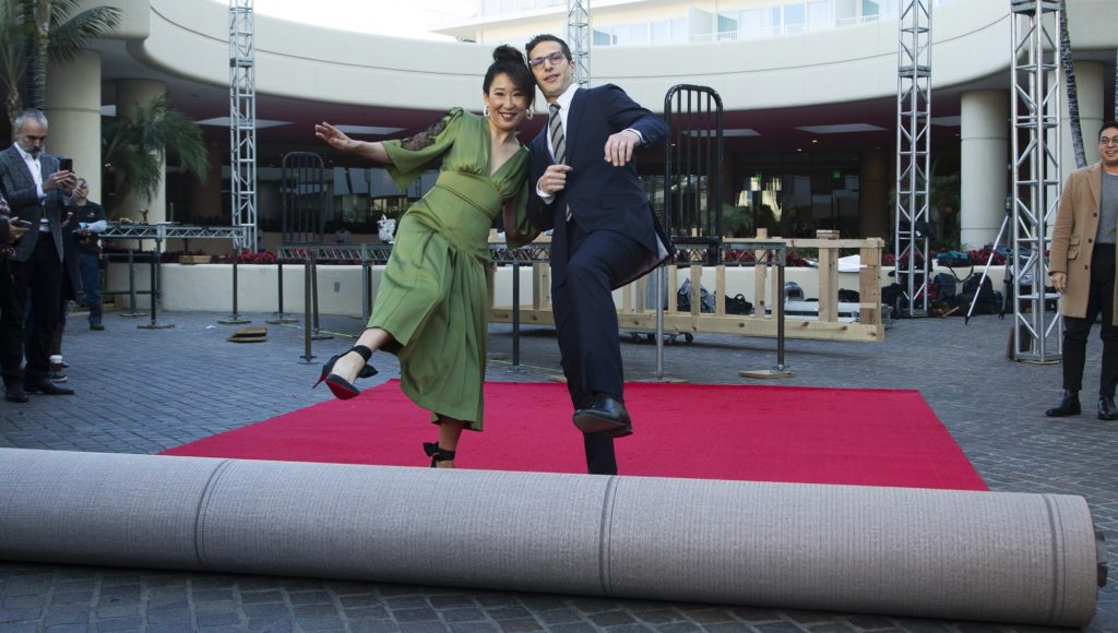 Sandra Oh, left, and Andy Samberg roll out the red carpet at the 76th Annual Golden Globe Awards Preview Day at The Beverly Hilton on Thursday, Jan. 3, 2019, in Beverly Hills, Calif. (Photo by Willy Sanjuan/Invision/AP)