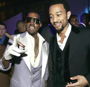 Kayne West and John Legend hang out at West's Grammy after party on Wednesday Feb. 8, 2006. The two had a lot to celebrate, West won three Grammy's and Legend won one. (AP Photo/Branimir Kvartuc)