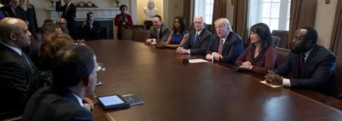 President Donald Trump and Vice President Mike Pence meets with members of the Congressional Black Caucus in the Cabinet Room of the White House in Washington, Wednesday, March 22, 2017. White House Director of communications for the Office of Public Liaison Omarosa Manigault is fifth from right. (AP Photo/Andrew Harnik)