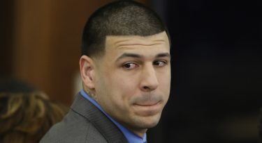 Former New England Patriots tight end Aaron Hernandez turns to look in the direction of the jury as he reacts to his double murder acquittal at Suffolk Superior Court Friday, April 14, 2017, in Boston. Hernandez stood trial for the July 2012 killings of Daniel de Abreu and Safiro Furtado who he encountered in a Boston nightclub. The former NFL player is already serving a life sentence in the 2013 killing of semi-professional football player Odin Lloyd. (AP Photo/Stephan Savoia, Pool)