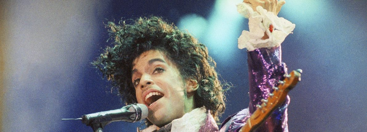 "FILE - In this Feb. 18, 1985 file photo, Prince performs at the Forum in Inglewood, Calif. A year after Prince died of an accidental drug overdose, his Paisley Park studio complex and home is now a museum and concert venue. Fans can now stream most of his classic albums, and a remastered ""Purple Rain"" album is due out in June 2017 along with two albums of unreleased music and two concert films from his vault. (AP Photo/Liu Heung Shing, File)"
