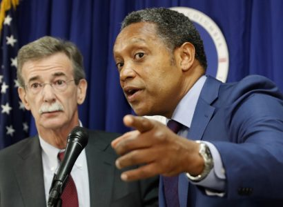 """District of Columbia Attorney General Karl Racine, right, accompanied by Maryland Attorney General Brian Frosh, speaks during a news conference in Washington, Monday, June 12, 2017, to discuss the lawsuit they filed against President Donald Trump. The lawsuit cites Trump's leases, properties and other business """"entanglements"""" around the world as the reason for the suit, saying those posed a conflict of interest under a clause of the Constitution.  (AP Photo/Alex Brandon)"""