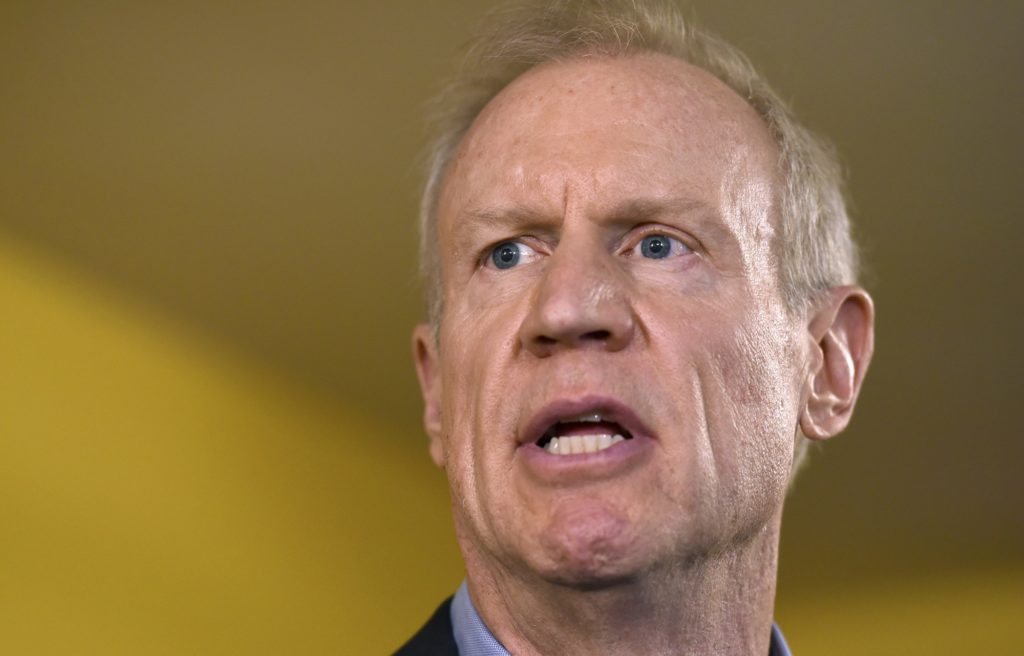 FILE - In this July 5, 2017, photo, Illinois Gov. Bruce Rauner speaks during a news conference in Chicago. Rauner is hardening his anti-tax stance as he readies a re-election bid following a major legislative defeat. (AP Photo/G-Jun Yam, File)