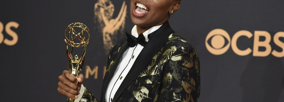 """Lena Waithe poses in the press room with the award for outstanding writing for a comedy series for the """"Master of None"""" episode """"Thanksgiving"""" at the 69th Primetime Emmy Awards on Sunday, Sept. 17, 2017, at the Microsoft Theater in Los Angeles. (Photo by Jordan Strauss/Invision/AP)"""