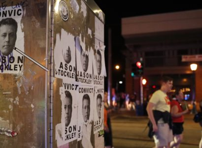People march past images of former St. Louis police officer Jason Stockley after a not guilty verdict in his trial  Saturday, Sept. 16, 2017, in St. Louis. Stockley was acquitted in the 2011 killing of a black man following a high-speed chase. (AP Photo/Jeff Roberson)