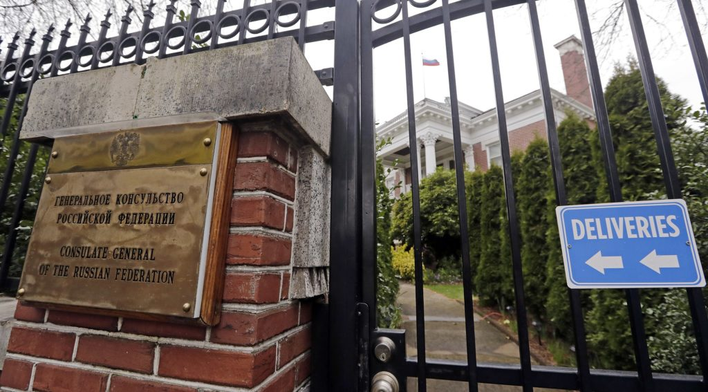 A metal fence surrounds the residence of Russia's consul general Monday, March 26, 2018, in Seattle. The United States and more than a dozen European nations kicked out Russian diplomats on Monday and the Trump administration ordered Russia's consulate in Seattle to close, as the West sought joint punishment for Moscow's alleged role in poisoning an ex-spy in Britain. (AP Photo/Elaine Thompson)