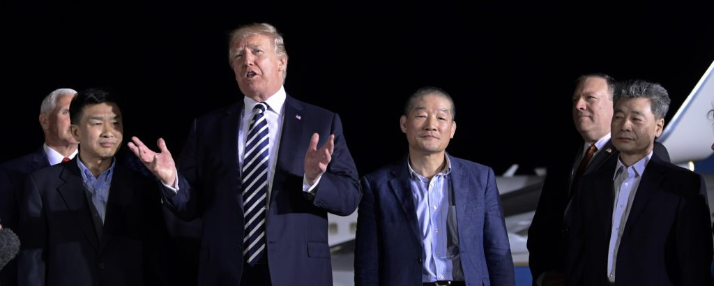 President Donald Trump speaks as he stands with Tony Kim, second left, Kim Dong Chul, center right, and Kim Hak Song, right, three Americans detained in North Korea for more than a year after they arrived at Andrews Air Force Base in Md., Thursday, May 10, 2018. Vice President Mike Pence, left, and Secretary of State Mike Pompeo, second from right, listen. (AP Photo/Susan Walsh)