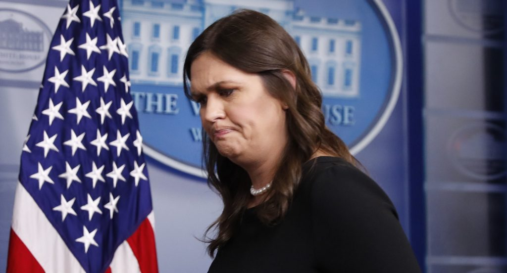 White House press secretary Sarah Huckabee Sanders walks away from the podium after speaking to the media at the daily briefing in the Brady Press Briefing Room of the White House, Thursday, June 14, 2018. (AP Photo/Pablo Martinez Monsivais)