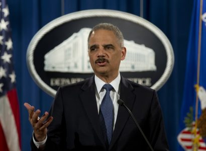 FILE - In this March 4, 2015 file photo, Attorney General Eric Holder speaks at the Justice Department in Washington. Holder is bidding farewell to the Justice Department after six years as the nation's top law enforcement official. Holder is scheduled to address Justice Department employees at a ceremony on Friday. (AP Photo/Carolyn Kaster, File)