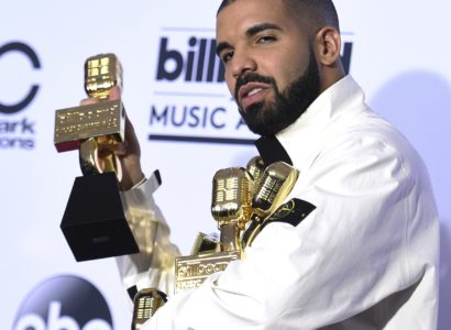 "Drake poses in the press room with his 13 awards at the Billboard Music Awards at the T-Mobile Arena on Sunday, May 21, 2017, in Las Vegas. Drake won for Top Artist, Top Male Artist, Top Billboard 200 Album for ""Views,"" Top Billboard 200 Artist, Top Hot 100 Artist, Top Song Sales Artist, Top Steaming Songs Artist, Top Rap Artist, Top Rap Tour, Top Rap Album for ""Views,"" Top Streaming Song (Audio) for ""One Dance,"" Top R&B Song for ""One Dance,"" and Top R&B Collaboration for ""One Dance."" (Photo by Richard Shotwell/Invision/AP)"
