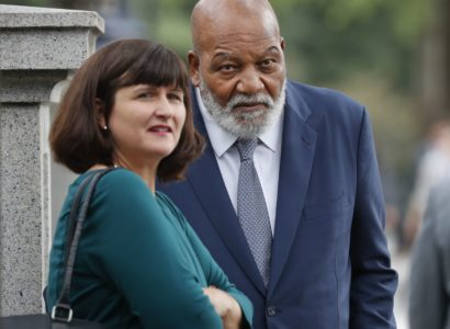 Hall of Fame football player Jim Brown, center, arrives at the White House in Washington, Thursday, Oct. 11, 2018. Brown and rapper Kanye West are scheduled to meet with President Donald Trump. (AP Photo/Pablo Martinez Monsivais)