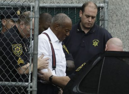 Bill Cosby departs after his sentencing hearing at the Montgomery County Courthouse, Tuesday, Sept. 25, 2018, in Norristown, Pa. Cosby left in handcuffs to begin serving a three-to-10 year prison sentence for sexual assault. (AP Photo/Matt Slocum)